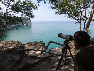 A four mile hike to a cliff at Pictured Rocks National Lakeshore gives us a clear view of a peregrine nest.  This is a very productive nest; in 2014, four young peregrines fledged from this site.